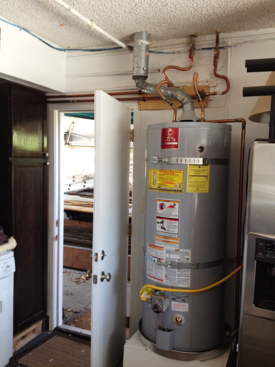 Water heater installed in garage by a plumber in Tukwila, Washington